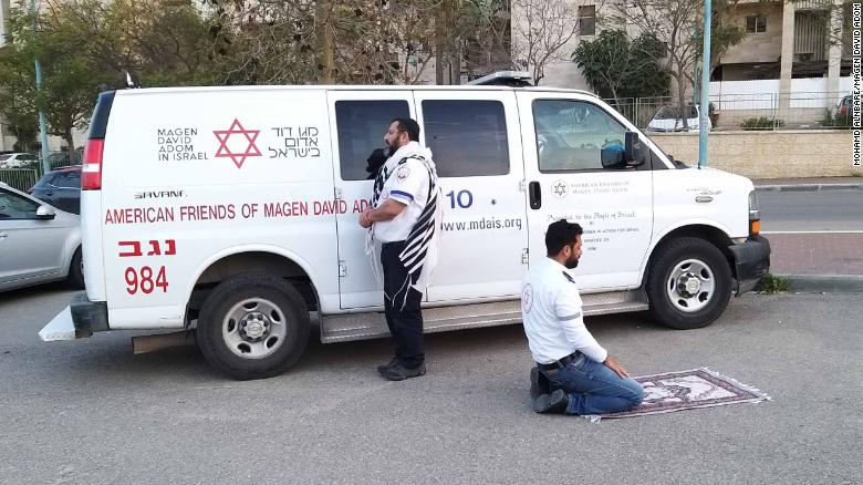 Muslim and Jewish paramedics pause to pray together. One of many inspiring moments in the coronavirus crisis